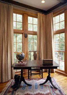 Master bedroom at Bayou Cottage. New construction of Bayou Cottage designed by Kevin Harris Architect, LLC