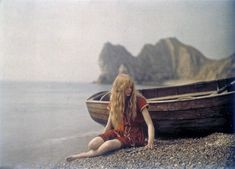 1913-- Christina in Red: Early colored photos of Christina O'Gorman, photographed by her father at Lulworth Cove, Dorset, England. Christina's choice of swimming costume was a fortuitous one since red was a color which the Autochrome process captured particularly well.
