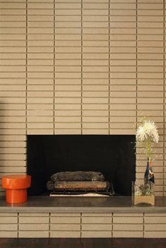 Mid-Century Mod fireplace.   Hmmm, maybe we could build out the fireplace wall to look more like this.
