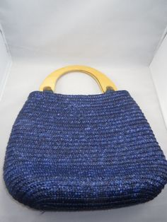 Cute dark blue reed weaved purse with zipper closure. Purse dimensions are 10in x 11.5in x 3in (h x l x w) with zipper and lined with cotton blue fabric and small inside zipper pocket (6in x 4.5in) with beautiful flat blonde bamboo handles. Most purses are rescued from thrift stores and friends if in great condition then cleaned and modified. All purses are packaged in protective materials. Please enjoy this wonderful purse.  www.etsy.com/listing/190190836