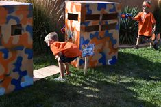 Nerf & Targets Party : Spray painted orange and blue camouflage boxes make  great bases for the kids to attack from in the Nerf Gun War.