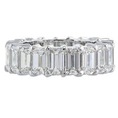 8.29 Carat Emerald Cut Diamond Platinum Eternity Band Ring   From a unique collection of vintage band rings at https://www.1stdibs.com/jewelry/rings/band-rings/