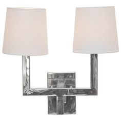 Nickel plated 2 arm sconce comes with 2 white linen shades. comes in gold too