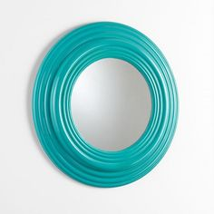 "The Coast Mirror is smooth and soft like Emerald Coast morning waves and is sure to bring a splash of color to any wall. 32""(dia) x 2.5""(ext)."