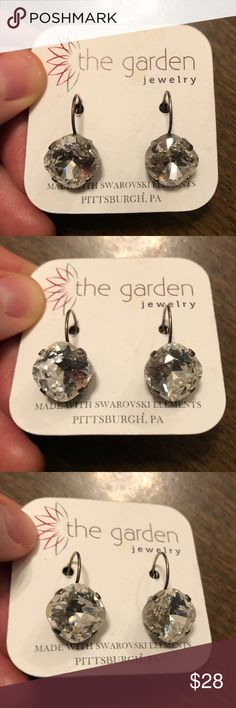 Swarovski earrings NWT Swarovski crystal earrings brand new with tag. Color of the crystals is clear crystal.  Made by The Garden in Pittsburgh, Pa.  beautiful earrings! Feel free to make offers or bundle with other items from my closet for a discount!! The Garden Jewelry Earrings