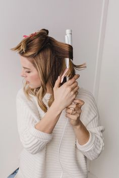 Bloglovin: wash, brush, and heat protect; split hair into two sections and curl; spray texturizing spray and comb through for loose, beachy waves