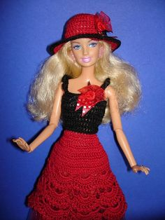 Set of 2 article - dress,hat for Barbie , exclusive design, black, red Material: 100% cotton , satin ribbon, beads A dress,hat is crocheted from cotton. Barbie doll's height is 30 cm/11.8 inches. Doll and other accessories not included. The dress on the back is fastened with velcro.