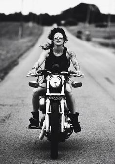 /// Sabrina Nova breakin' the law, taking a little freedom ride through the Tennessee countryside on her Harley Davidson 883.