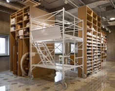 schemata architecture office - hue+, a food photography studio... could use this in a loft with the scaffolding being converted into beds!!!  Then use curtains to be pulled at night when sleeping or quiet time.
