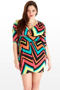 Get energized on a night out in this bright, bold and unapologetically sexy dress, sure to get any bartender's undivided attention. Fun and daring neon print traverses the low V-neckline, elbow dolman sleeves, cummerbund waist and volumetric skirt. Don a bright gold necklace, sip a flirty pink drink, and you'll paint with every fashion crayon in the box.