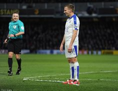 Watford 0 Leicester City 1: RefereeJohn Moss shares a light moment in the first-half after he comically put vanishing spray on Marc Allbrighton's boots.