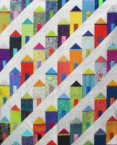 The Painted Ladies are those riotously colorful Victorian houses set in the hills of San Francisco. That iconic neighborhood inspired this pattern by Eye Candy Quilts.