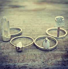 Bohemian and gypsy inspired rings. Platinum or silver bands with natural rocks and gems as a large statement.