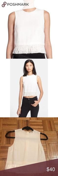 "A.L.C. Kennedy Fringe Hem Crepe Crop Top Silky fringe ends a clean-lined crop top cut from supple crepe. 18 1/2"" length (size 8). Back zip closure. Jewel neckline. Sleeveless. 97% viscose, 3% spandex. A.L.C. Tops Blouses"