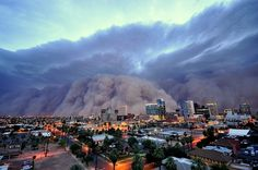 How awesome is this epic HABOOB photo of a dirt cloud enrobing downtown Phoenix! Photo by: Daniel Jamen Bryant