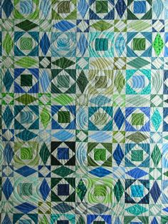 Close-up: wavy quilting by Candy Stiffler at Quiltvine, on a Storm at Sea quilt made by the 7-Sisters Quilt Guild
