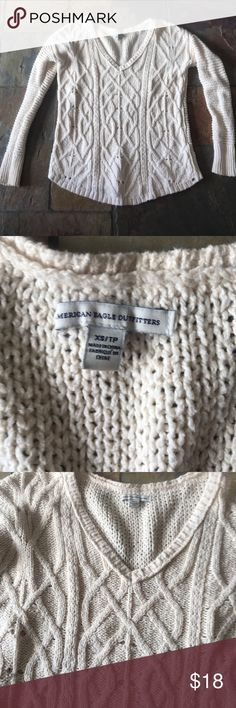 """AEO sweater Ivory open knot sweater by American Eagle Outfitters. V-neck. Size XS. 85% cotton/15% polyester. Shoulder to hem 24"""". Armpit to armpit 19"""". American Eagle Outfitters Sweaters"""