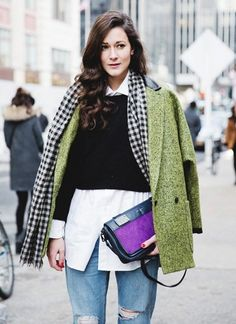 This girl stays stylish and warm with multiple layers: crisp button-up + cropped sweater + checked scarf + green coat + ripped jeans... - Street Style