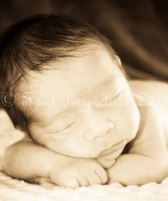 Newborn boy  Ethan could look something like this....so curious!!