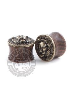 """Description What is it? Aslan is on the move with these rockin' wood plugs. Easy on the ears and great for healed piercings! 🦁 Product Details What is it made of? Material: Ebony Wood Plug Size: 0g-5/8"""" Wearable Area: 8.8mm *Please note that these measurements are based on averages* Class: Wood Color: Wood with golden lion face inlay. Golden Lions, Wood Plugs, Plugs Earrings, Tunnels And Plugs, Stretched Ears, Wood Colors, Body Jewelry, Jewelry Collection, Piercings"""