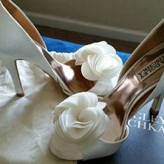 Badgley Mischka Bridal Shoes Blossom by Badgley Mischka. Blossom is a feminine and romantic style with a ruffled decoration at the toe. Layers of soft laser-cut petals create a modern ruffle accent. The chic detail makes this open-toe, d'orsay shoe truly unique. **Worn Once. Kept in original shoe box, comes with additional heel tips, true to fit**  Heel height: 4 1/4 inches Badgley Mischka Shoes Heels