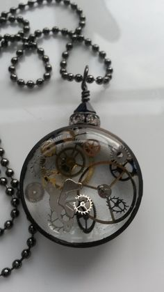 Steampunk copper pipe watch parts necklace.