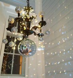 ❥ Using Christmas mirror balls to make a holiday decoration. led battery lights.  Easy, fast, cheap decoration