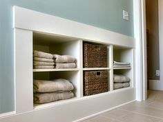 Go Into the Wall    For extra storage, consider building recessed shelves into a wall. You may only be able to go a few inches deep, but it may be adequate enough to hold towels, detergents and laundry supplies.