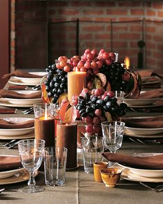 The jewel tones and cascading abundance of these arrangements are an ode to autumn. Set in gleaming containers, extra-big black and crimson grapes give a nod to that ubiquitous Thanksgiving motif: the cornucopia.