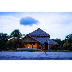 Waiakea Ohana Matt Hoffman walking back at dusk after a long day of surfing in Nicaragua ||  Photo Brian Clifford