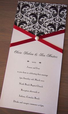 This wedding invitation called Bold Damask has been made using black and white pearlescent deco paper with a damask pattern, ruby red satin ribbon, pearlescent white text paper and a single pearl stud. The invitation has a red backing, just for something a bit different. It comes with a pearlescent white envelope. (https://www.etsy.com/listing/124067848/bold-damask-wedding-invitation)