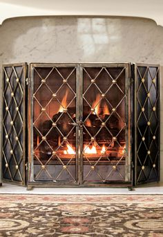 Moroccan inspired clover and star pattern glass backed fireplace ...