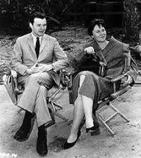 A black and white photograph of Alan J. Pakula seated next to Harper Lee in director's chairs watching the filming of To Kill a Mockingbird Harper Lee, People Icon, To Kill A Mockingbird, Chapter 16, Book People, American Literature, Writers Write, Famous Women, Film Movie