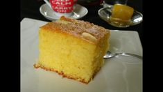Revani (pr. Reh-vah-KNEE) sometimes also written as ravani, is a light semolina sponge cake made with either butter or olive oil and Greek yoghurt, decorated with blanched almonds and bathed in syrup. #revani #ravani #semolinacake #Greekdesserts #traditional desserts Greek Desserts, Greek Recipes, Greek Cake, Semolina Cake, Olive Oil Cake, Blanched Almonds, Cinnamon Almonds, Cake Videos, How To Make Cake