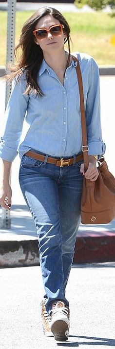 Who made Emmy Rossum's print sneakers, brown bucket handbag, and leather belt?