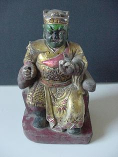 ANTIQUE CHINESE WOOD CARVED HANDPAINTED SEATED DEITY GLASS? JEWEL? EYES 9""