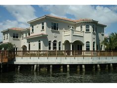 Gorgeous waterfront Mediterranean style home | Luxury House Plan Rear Photo of House Design 106S-0063 | House Plans and More