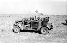 North-Africa, 1942. German soldiers drive their Kubelwagen through the desert.