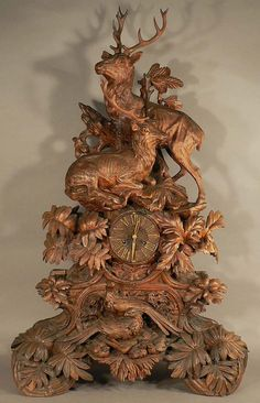 naturalistically carved mantel clock with a stag family, swiss brienz ca. 1880