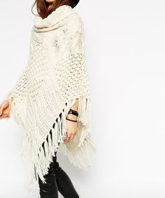 NAME Womens Capes And Ponchoes    SIZES    * Clothing Length (cm) / 95 * Clothing Bust (cm) / 80-95     COLORS Beige   DESCRIPTION  Fashion crochet patterns, a variety of changes, fringed hem design, like a clever melodies, high collar, in the winter, can be good for your neck warm, ...
