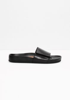 Crafted from leather, these comfortable slippers have a clean and simple design.