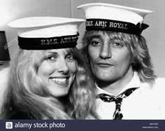 Rod Stewart singer with Alana Hamilton wearing Royal Navy HMS Ark Royal Caps during a visit on board the aircraft carrier before