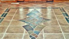 Customized special tile floor design for entry way. Used custom design using colored custom cut tiles.