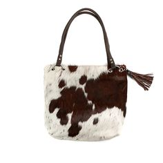 ec29638590e4 The Zulucow Cowhide Slouch Shoulder Bag boasts a dramatic cowhide front and  sumptuous natural full leather