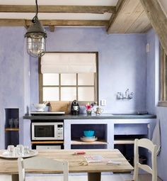 A rustic barn light pendant is a natural for this industrial farmhouse kitchen. Salvaged wood, antique furniture, and rustic lighting add up to vintage charm! Lavender Kitchen, Purple Kitchen, Kitchen Colors, Kitchen Design, Nice Kitchen, Kitchen Ideas, Bed And Breakfast, Purple Dining Chairs, Industrial Farmhouse Kitchen
