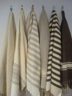 Interesting way to store and display handwoven blankets and throws.