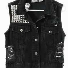 """I saw the most amazing vest with very GaGa-like tassels around the arms the other day, but I'm also liking the punk-bad-ass vibe I'm getting from this. I call trendy vests becoming """"in""""."""