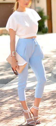 Wheretoget - White crop top, pastel baby blue pants, white high-heeled sandals, nude clutch and sunglasses