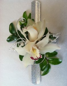 "white mini cymbidiums with silver and pearl ""leaves"" on a silver snap bracelet."