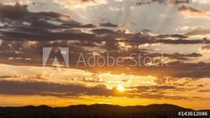 Stock Footage of Static timelapse at sunset with a silhouette mountain range and clouds rollings past against dramatic golden and orange sky going dark available on request. Explore similar videos at Adobe Stock Sky Go, African Sunset, Orange Sky, Mountain Range, Stock Video, Stock Footage, Sunsets, Adobe, Past